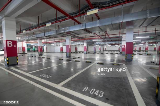 underground parking lot parking space - parkplatz stock-fotos und bilder