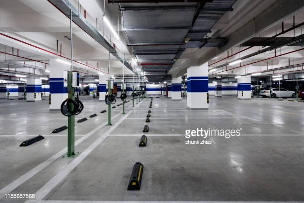 underground parking lot - electric vehicle charging station stock pictures, royalty-free photos & images