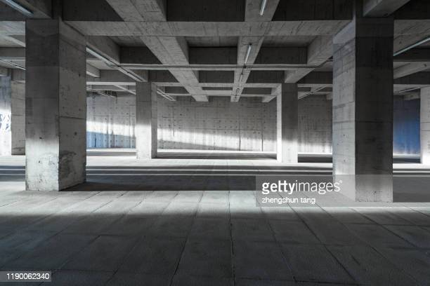 underground parking lot - 人気のない道路 ストックフォトと画像