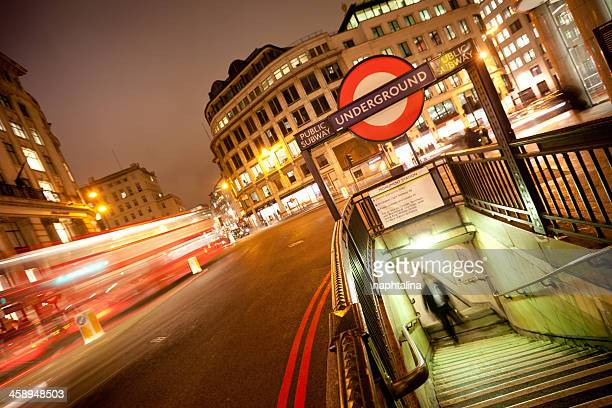 Underground sign and bus in London