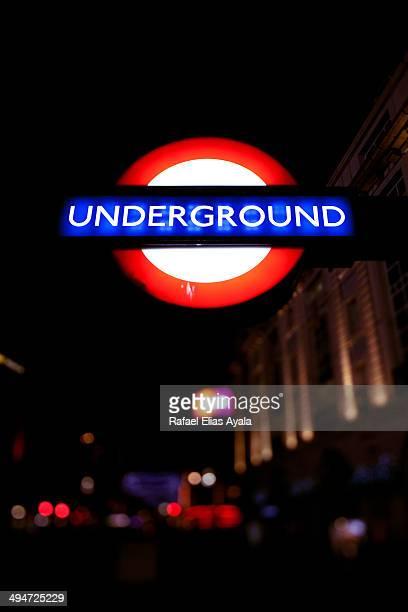 CONTENT] Underground sign at night London United Kingdom