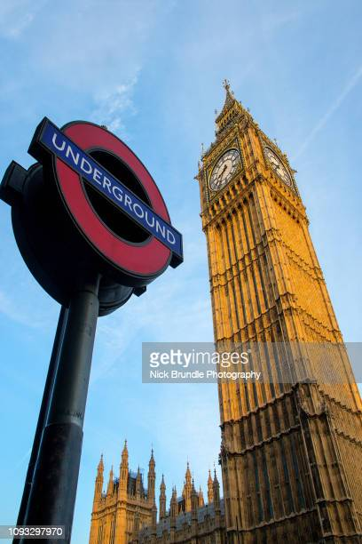 underground station & the houses of parliament big ben - paris metro sign stock pictures, royalty-free photos & images