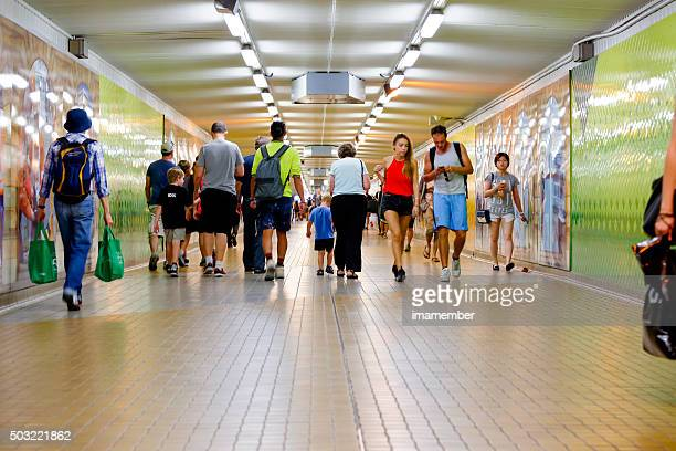 Underground subway in rush hour with passengers and travellers