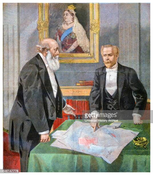 Underneath a portrait of Queen Victoria Lord Salisbury and Paul Cambon examine a map appendix to the AngloFrench Convention of 1898 also known as the...