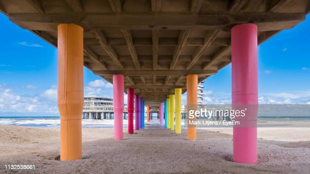 underneath of bridge at beach against sky - the hague stock pictures, royalty-free photos & images