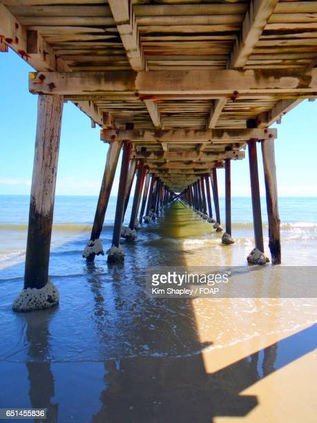 underneath of wooden jetty - semaphore stock pictures, royalty-free photos & images