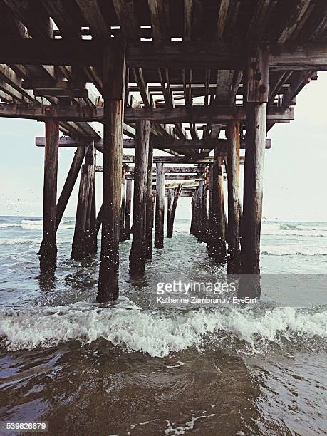 underneath view of pier at sea - atlantic city stock pictures, royalty-free photos & images