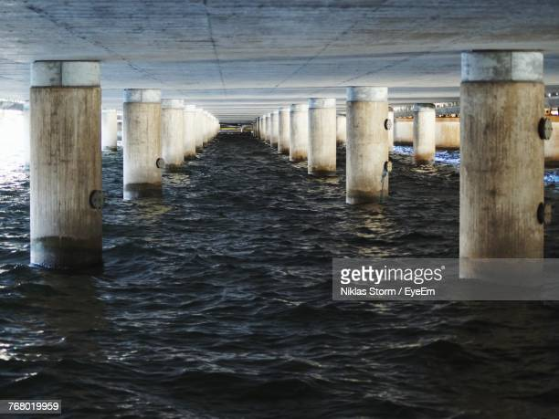 underneath view of pier over sea - niklas storm eyeem stock photos and pictures
