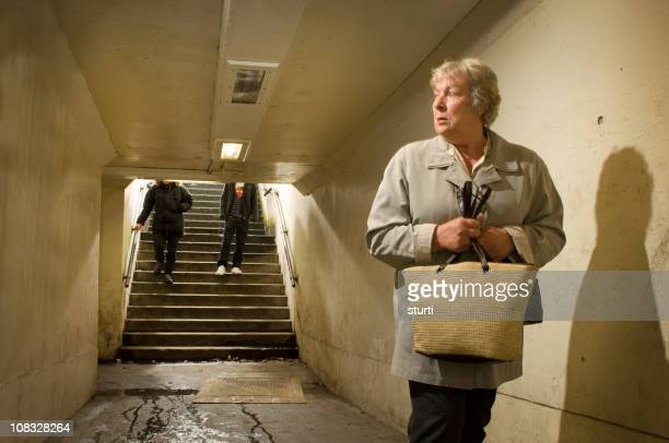 underpass danger - stalker person stock photos and pictures