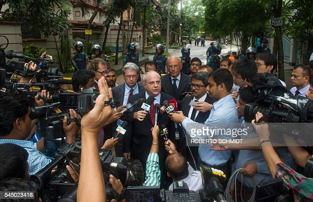 UnderSecretary for the Italian Ministry of Foreign Affairs Mario Giro speaks to members of the media at a road block near an upscale restaurant where...