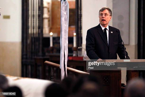 S Undersecretary of State Patrick Kennedy looks towards the family of US diplomat Anne T Smedinghoff as he eulogizes her during her funeral Mass at...