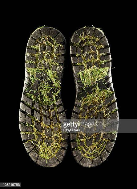 Underside of Dirty Shoes with Grass and Mud