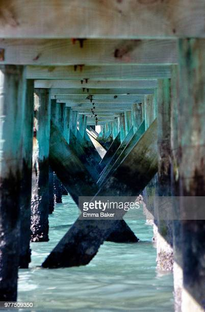 underside of jetty, auckland, new zealand - emma baker stock pictures, royalty-free photos & images