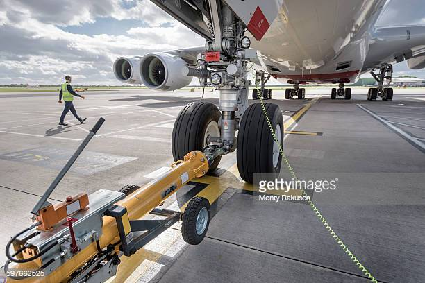 Underside view of A380 aircraft attached to towing tug