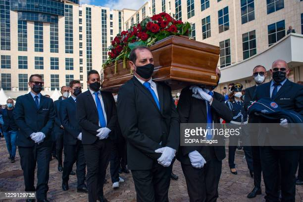 Undertakers carrying the coffin during the funeral. At the Regional Citadel in Catanzaro was the last tribute for Jole Santelli, Governor of Calabria...
