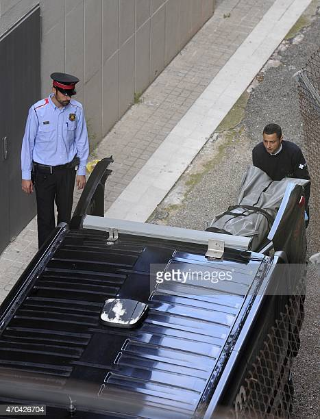 Undertakers remove the body of a teacher who resulted dead at the Joan Fuster Institue in Barcelona on April 20 2015 after a student allegedley broke...
