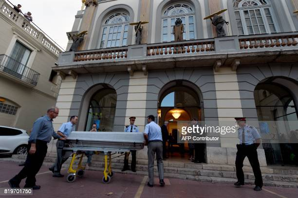 Undertakers take a casket inside the TeatreMuseu Dali after the arrival of forensic examiners for the exhumation of Salvador Dali's remains in...