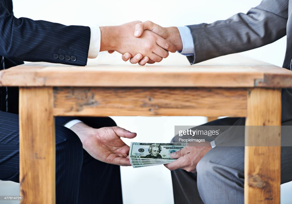 Under-the-table transactions... : Stock Photo