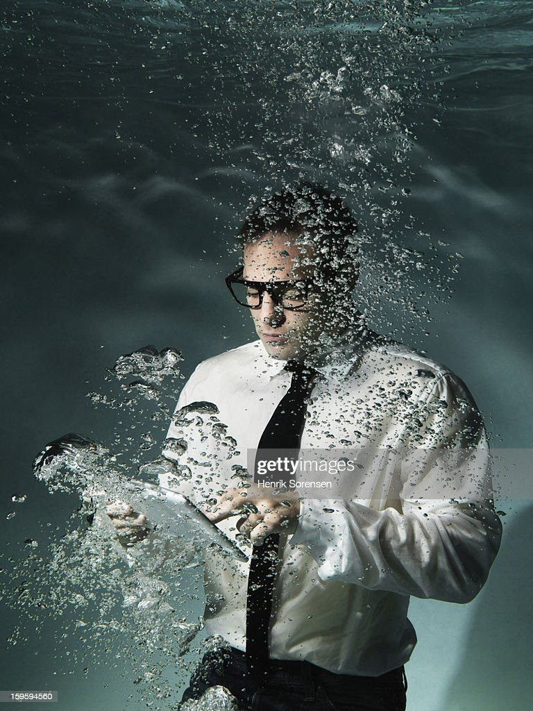 Underwater businessman.(With tablet) : Stock Photo