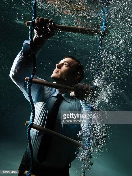 Underwater businessman.(Climbing up)