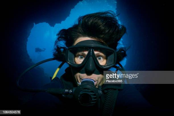underwater extreme sports cave diving woman scuba diver selfie - aqualung diving equipment stock pictures, royalty-free photos & images