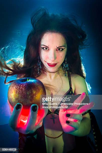 Underwater lovely Eve with the apple of seduction