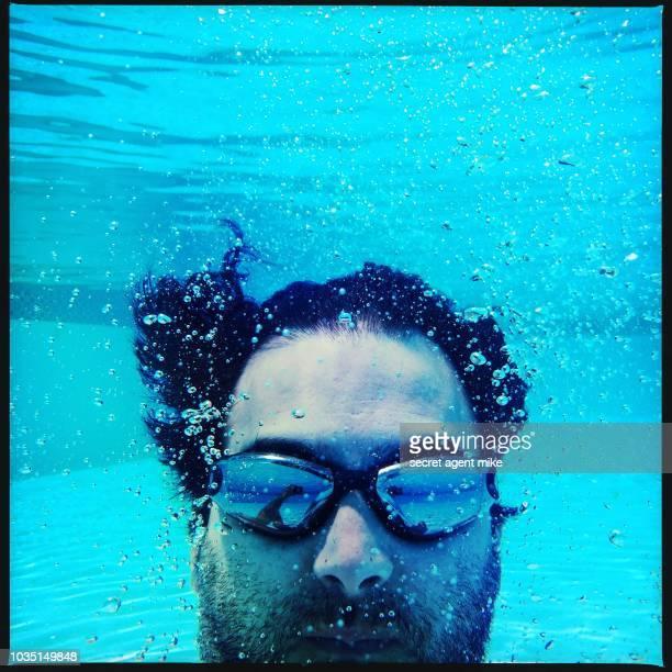 underwater man in pool