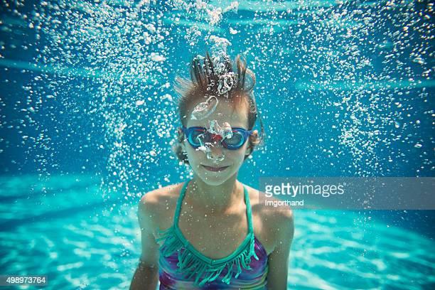 Underwater portrait of a little girl