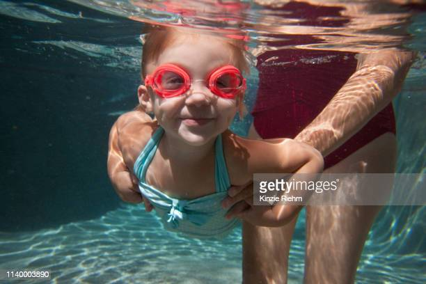 underwater portrait of girl learning to swim - sport venue stock pictures, royalty-free photos & images