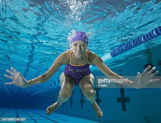 Underwater portrait of senior woman in pool