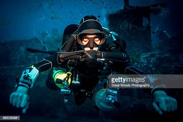 Underwater portrait of technical diver using a rebreather device to locate shipwreck, Lombok, Indonesia
