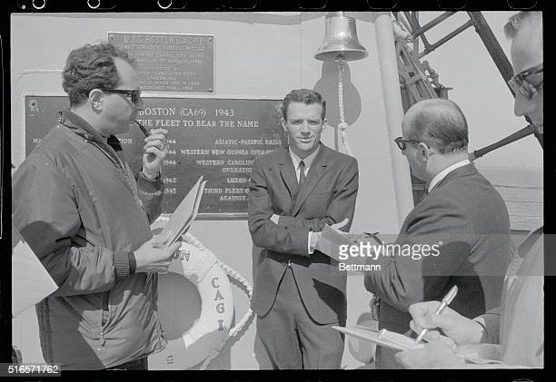 Underwater research specialist Jon Lindbergh, son of famed flier, talks with newsman aboard the guided missile cruiser U.S.S. Boston, flagship of the...