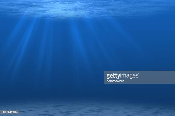 Underwater scene with beams of sunlight streaming through