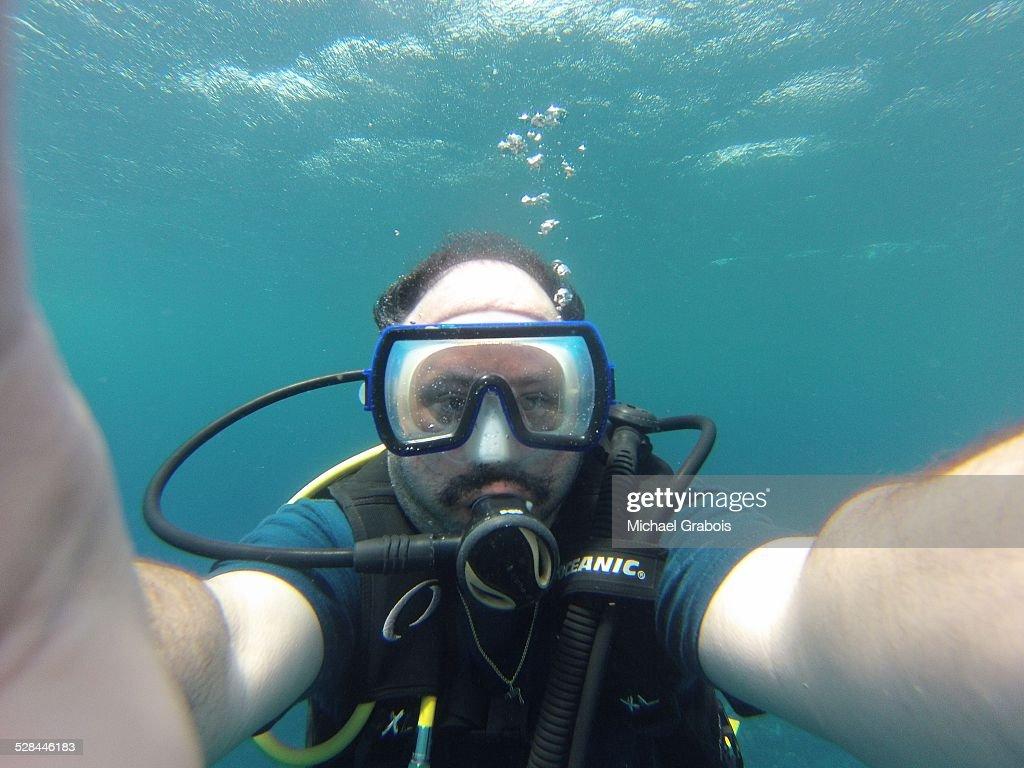 Underwater selfie while scuba diving off the coast of Roatan, Honduras