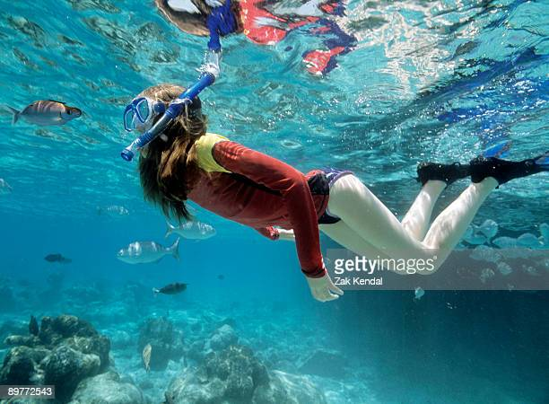 underwater shot of girl snorkeling