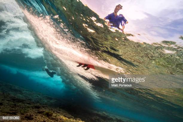 Underwater shots of surfers