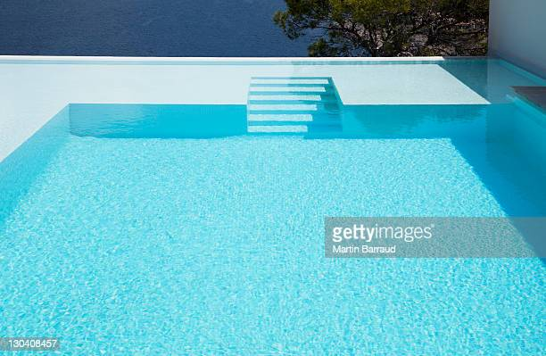 underwater steps in infinity pool - pool stock pictures, royalty-free photos & images