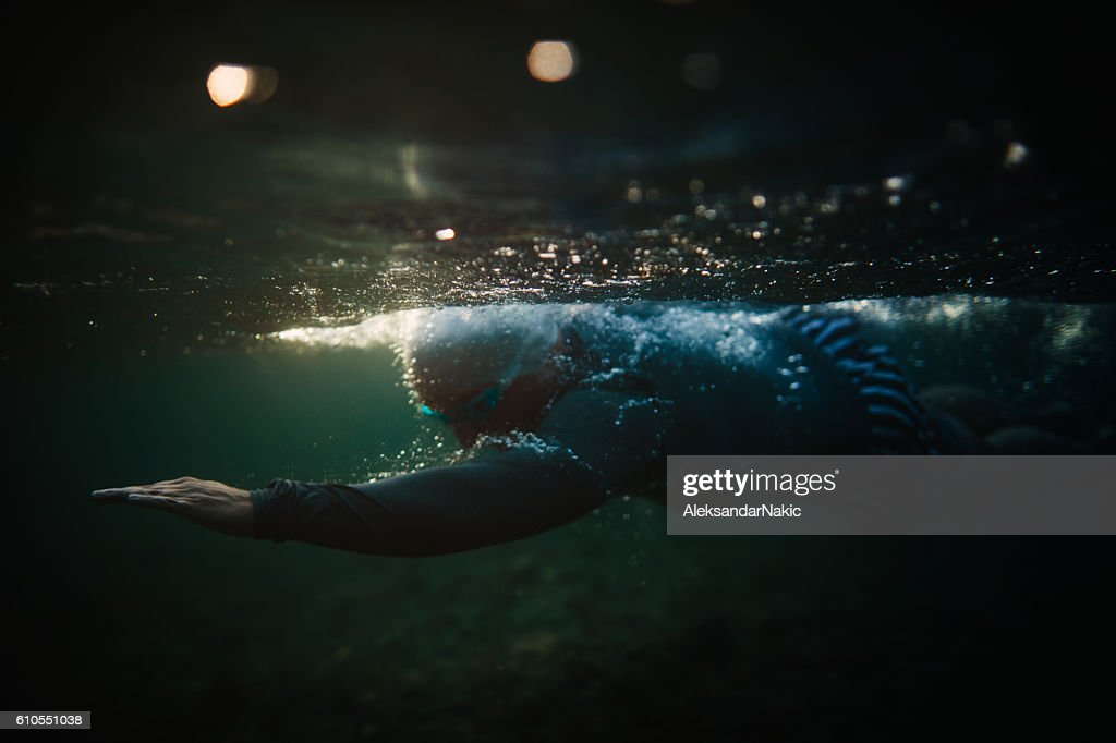 Portrait of a determined male swimmer captured while underwater
