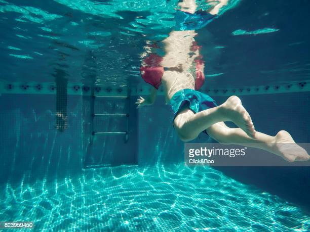 Underwater view of a four years old boy