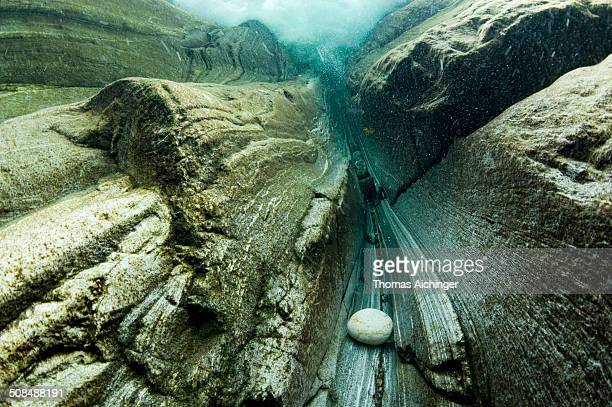 underwater view of a waterfall in the verzasca river, lavertezzo, valle verzasca, canton ticino, switzerland - river bed stock photos and pictures