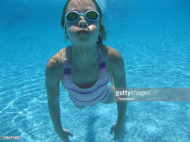 Underwater view of a young girl swimming, Moorea, Tahiti, French Polynesia, South Pacific