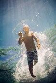 underwater view boy swimming underwater sea