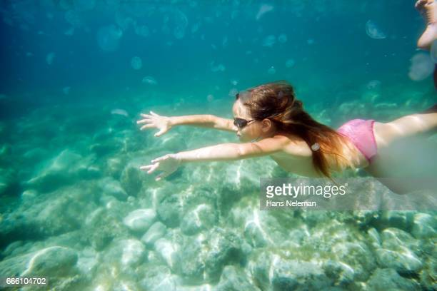 underwater view of girl diving - bikini bottom stock pictures, royalty-free photos & images