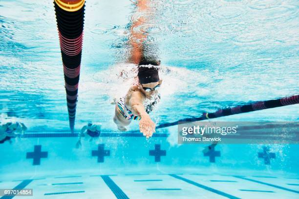 Underwater view of mature female swimmer during workout