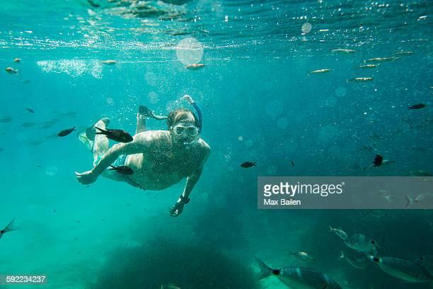 Underwater view of mature man snorkeling, Menorca, Balearic islands, Spain