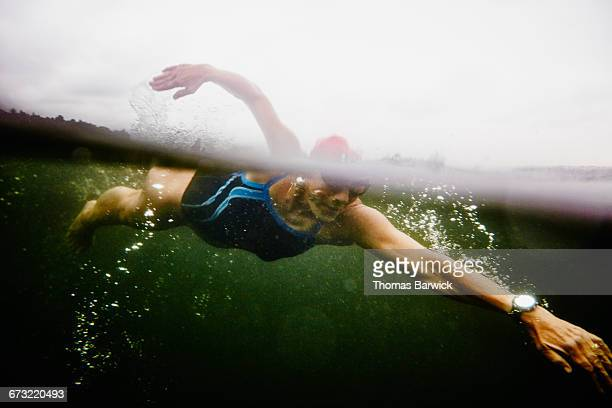 Underwater view of mature woman on open water swim