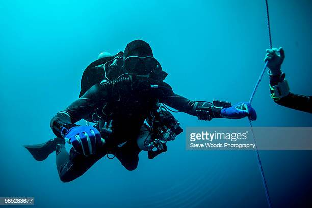 Underwater view of technical diver using a rebreather device to locate shipwreck, Lombok, Indonesia