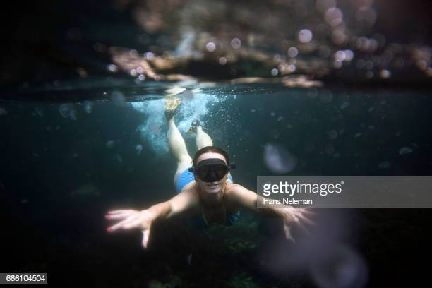 Underwater view of woman diving