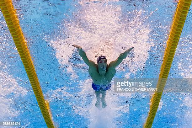 TOPSHOT Underwater view shows USA's Michael Phelps taking part in the Men's 100m Butterfly Semifinal during the swimming event at the Rio 2016...