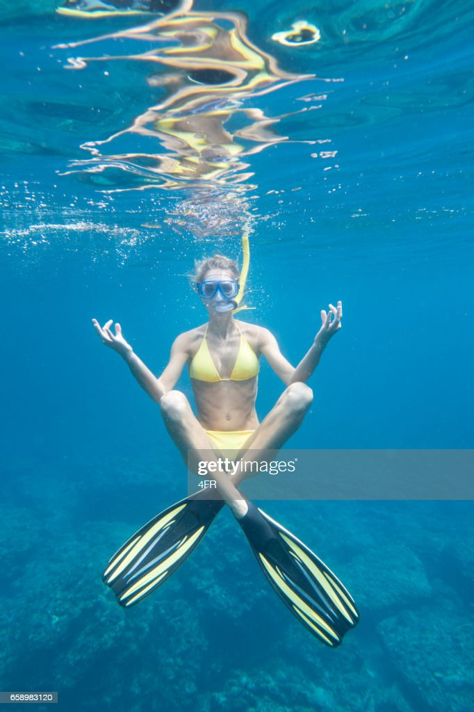 Underwater Yoga, Woman with Fins and Snorkel : Stock Photo